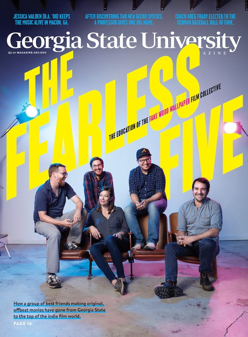 Magazine cover of 4 men and a woman sitting under banner the Fearless Five