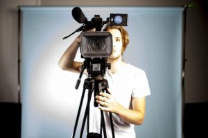 Male behind video camera
